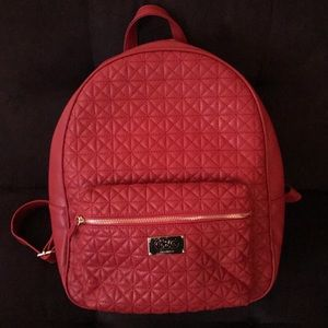 Red faux-leather backpack